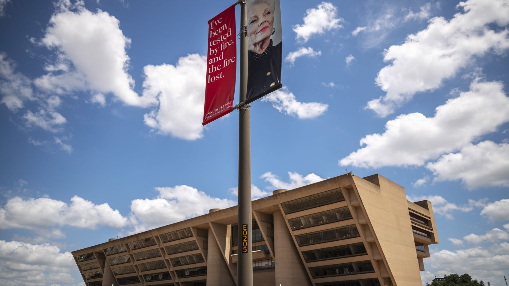 A banner is on display of former Texas Governor Ann Richards along Akard Street near Dallas City Hall in Downtown Dallas, on Thursday, June 24, 2021.