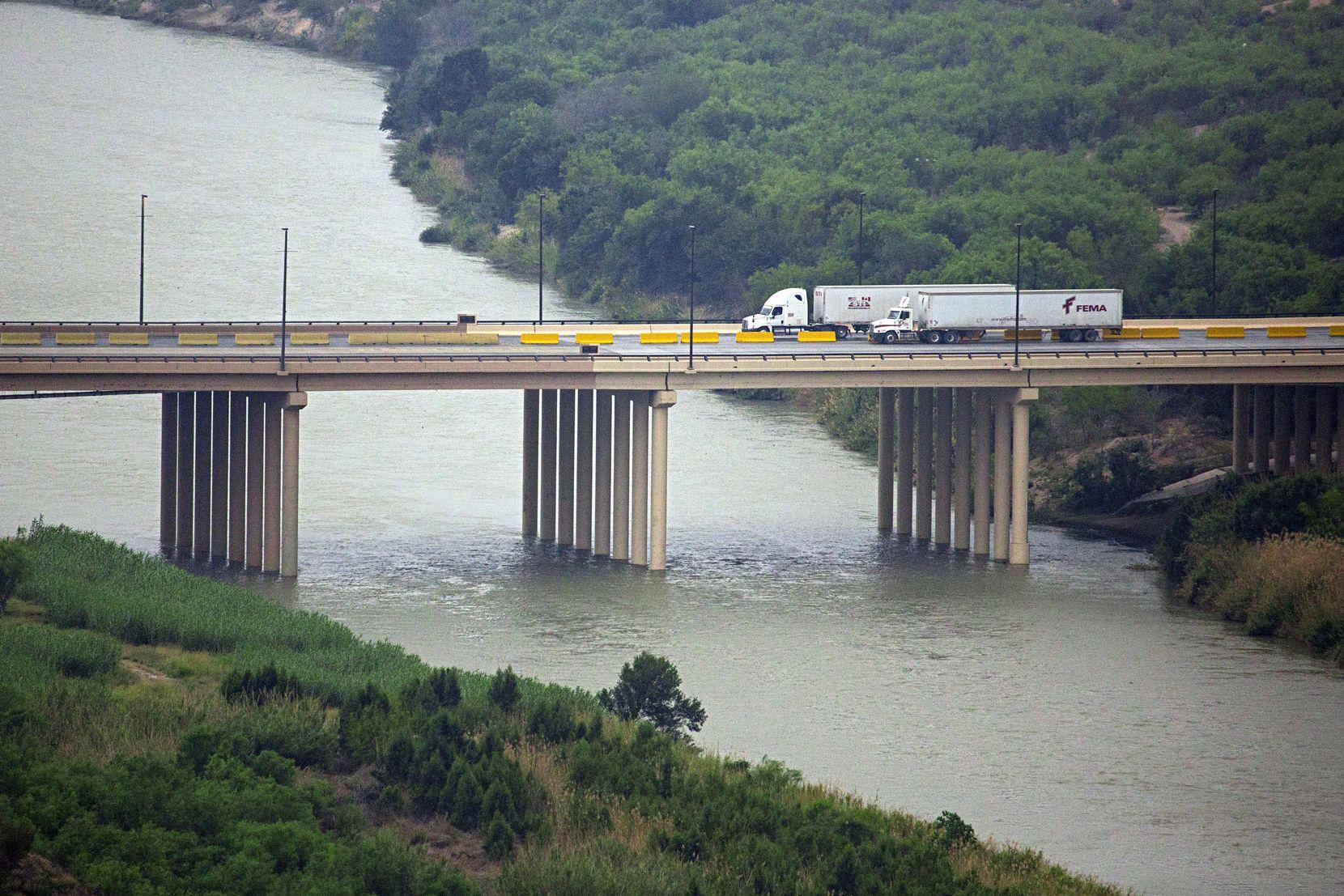 Trucks cross over the Laredo World Trade Bridge between Nuevo Laredo, Mexico (right) and the United States.