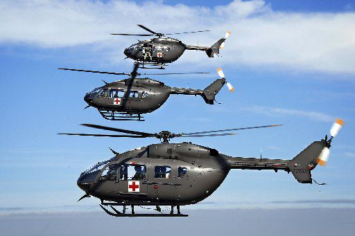 """This undated photo, provided by EADS North America, shows three UH-72A Lakota helicopters. The Army is spending $2.6 billion on a fleet of European-designed helicopters for homeland security and disaster-relief missions that cannot be used in hot weather because their cockpits overheat, according to an internal report obtained by The Associated Press. The internal report, prepared for the Army last summer, said the helicopter is effective in light-duty missions """"but is not effective for use in hot environments or for medical evacuation of two litter patients requiring critical medical care."""" (AP Photo/EADS North America) FX104 11102007xNEWS"""