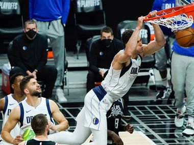 Dallas Mavericks center Dwight Powell (7) dunks the ball past LA Clippers forward Marcus Morris Sr. (8) and center Ivica Zubac (40) during the first half of an NBA playoff basketball game at the Staples Center on Wednesday, June 2, 2021, in Los Angeles.
