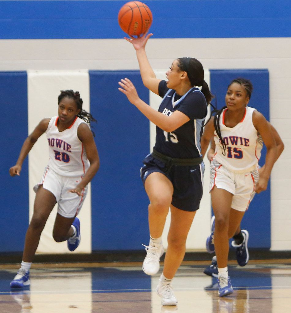 Hurst L.D. Bell guard Myra Gordon (15) leans over her shoulder to pull in a lead pass during a first quarter fast break as Arlington Bowie defenders Aleyah Simmons (20) and Alaisha Brown (15) give chase. The Bell Lady Raiders won, 82-53 to advance. The two teams played their Class 6A bi-district girls basketball game at Grand Prairie High in Grand Prairie on February 17, 2020. (Steve Hamm/Special Contributor).