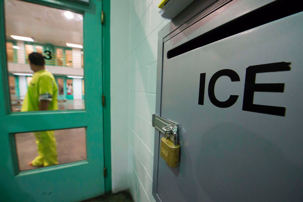 An immigration detainee stands near an US Immigration and Customs Enforcement (ICE) grievance box in the high security unit at the Theo Lacy Facility, a county jail which also houses immigration detainees arrested by the US Immigration and Customs Enforcement  (ICE), March 14, 2017 in Orange, California, about 32 miles (52km) southeast of Los Angeles.  US President Donald Trumps first budget provides more than USD 4.5 billion in new spending to fight illegal immigration by adding immigration and border enforcement agents, prosecutors and judges, as well as building a wall on the border with Mexico. / AFP PHOTO / Robyn BeckROBYN BECK/AFP/Getty Images