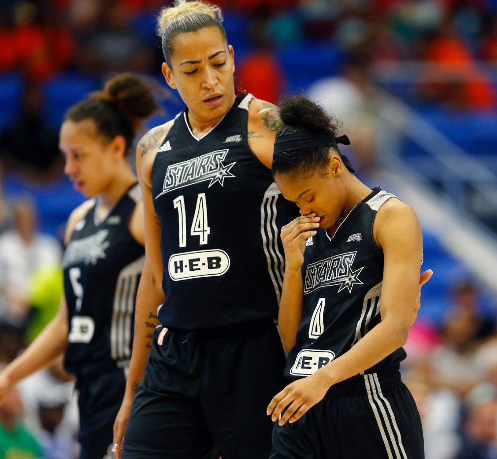San Antonio Stars forward Erika de Souza (14) consoles guard Moriah Jefferson (4) in the last moments of the game  at UTA's College Park Center in Arlington, Texas on June 21, 2017.  (Nathan Hunsinger/The Dallas Morning News)