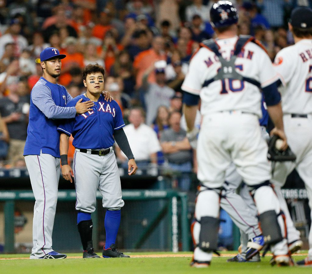 HOUSTON, TX - MAY 01:  Shin-Soo Choo #17 of the Texas Rangers is restrained by Yu Darvish #11 after the benches cleared after Lance McCullers Jr. of the Houston Astros threw a pitch behind Mike Napoli in the sixth inning at Minute Maid Park on May 1, 2017 in Houston, Texas.  (Photo by Bob Levey/Getty Images)