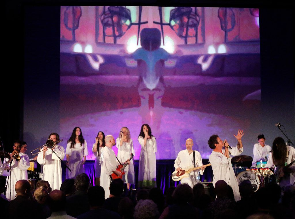 A performance by The Polyphonic Spree, led by singer Tim DeLaughter (right), closed out the Dallas Festival of Ideas on Saturday in downtown Dallas. (Tom Fox/Staff Photographer)