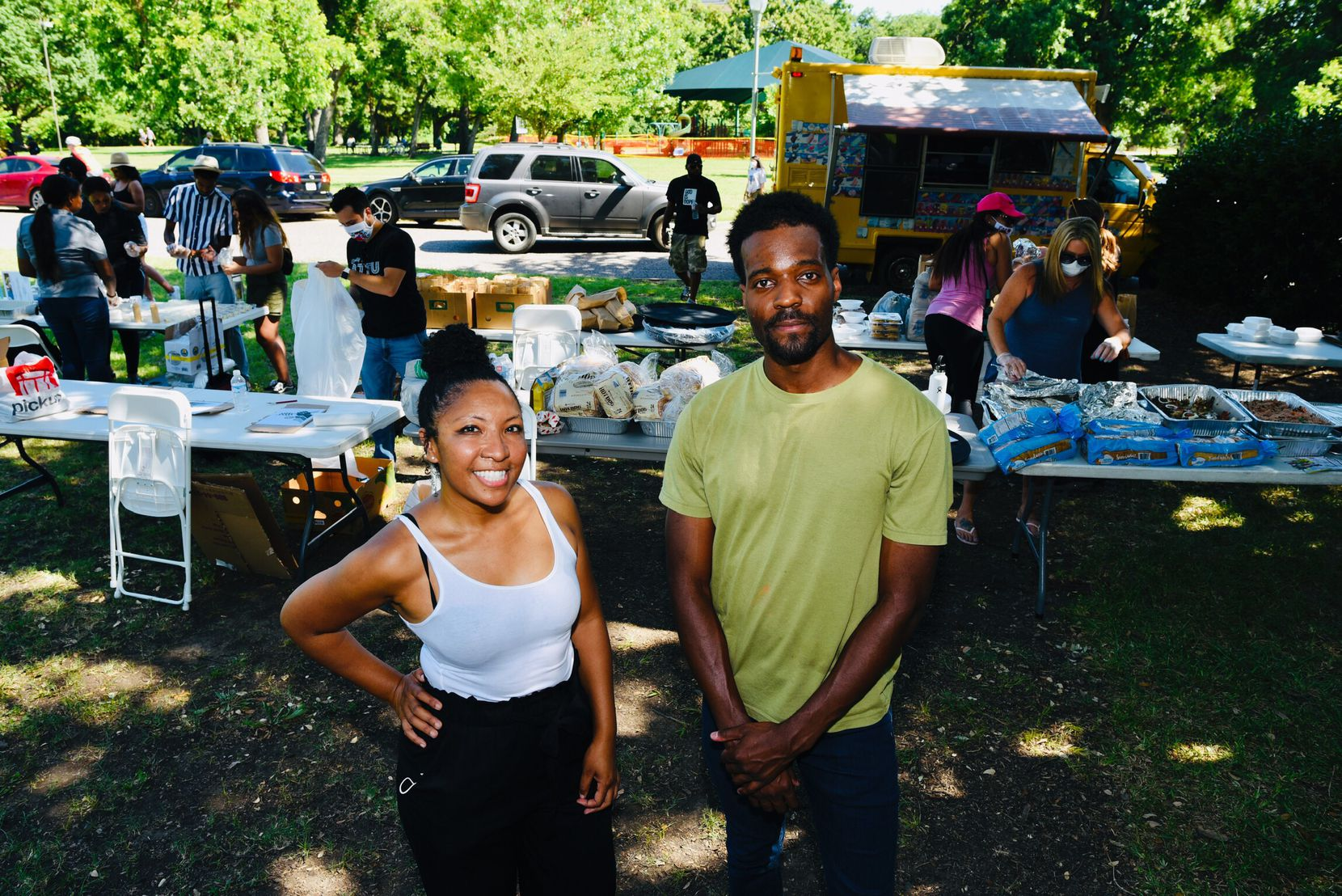 Deah Berry Mitchell, vendor organizer, and Jeziel Jones, head organizer for the Potluck Protest, pose at the vendor tables during the Potluck Protest to support Black-owned restaurants, Saturday, June 13, 2020 at Reverchon Park in Dallas.