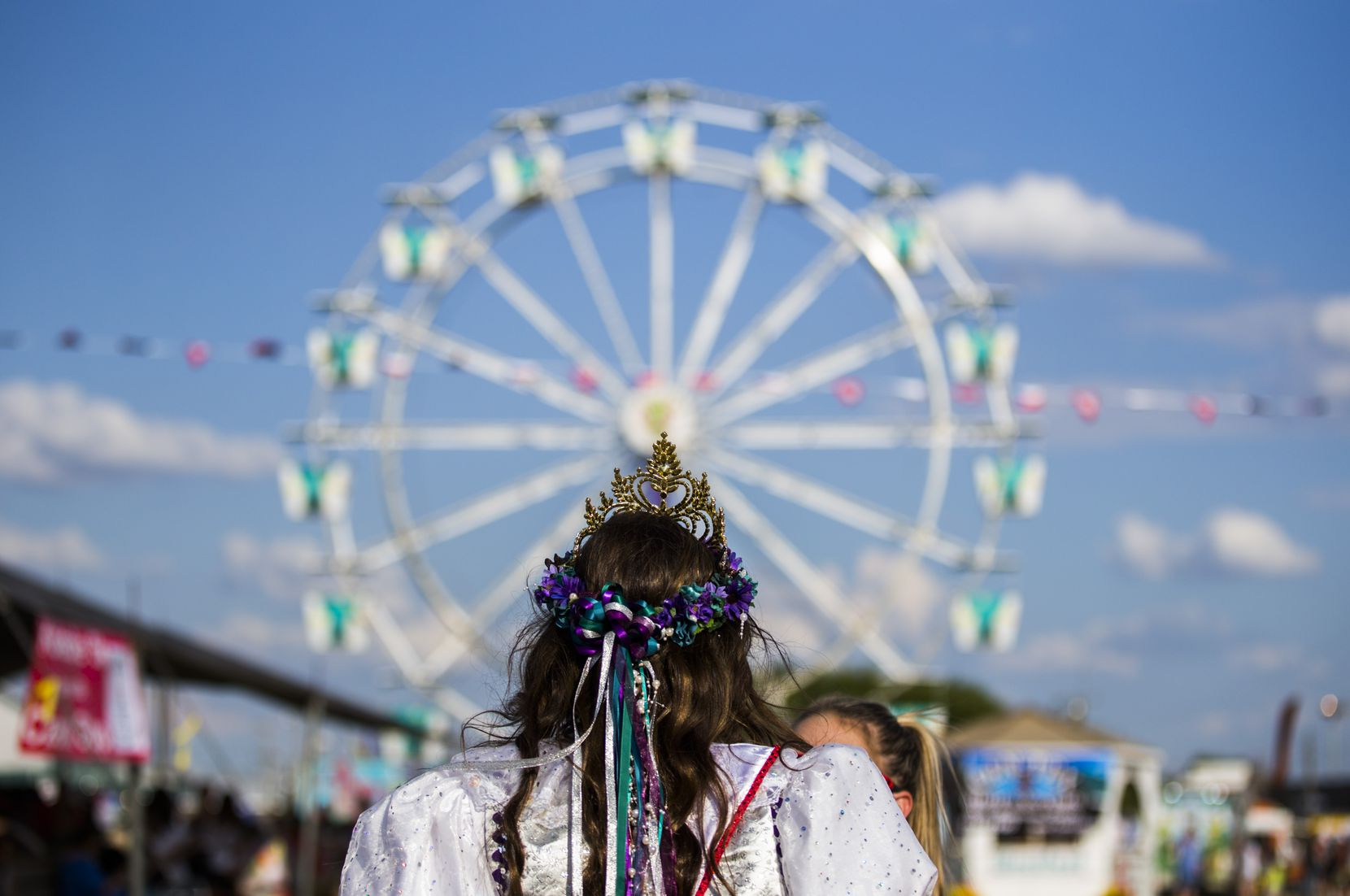 Miss West Fest 2018 Abby Kolar, 18, walks toward a Ferris wheel on the West Fest grounds on September 1, 2018 in West, Texas.