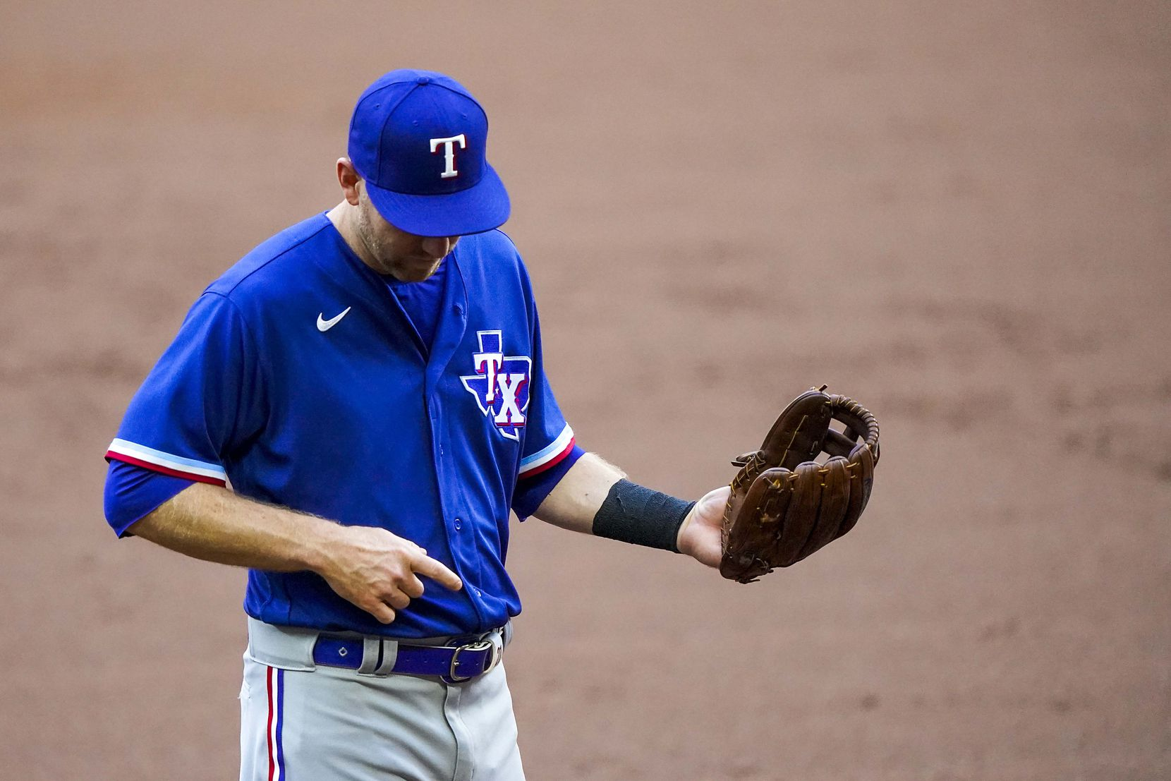 Third baseman Todd Frazier plays air guitar between batters in an intrasquad game during Texas Rangers Summer Camp at Globe Life Field on Friday, July 17, 2020.