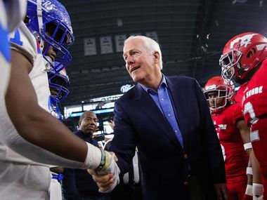 Duncanville players shake hands with U.S. Sen. John Cornyn before a Class 6A Division I state championship game against Galena Park North Shore at the AT&T Stadium in Arlington, on Saturday, December 21, 2019. The game is tied won 17-17 at halftime. (Juan Figueroa/The Dallas Morning News)