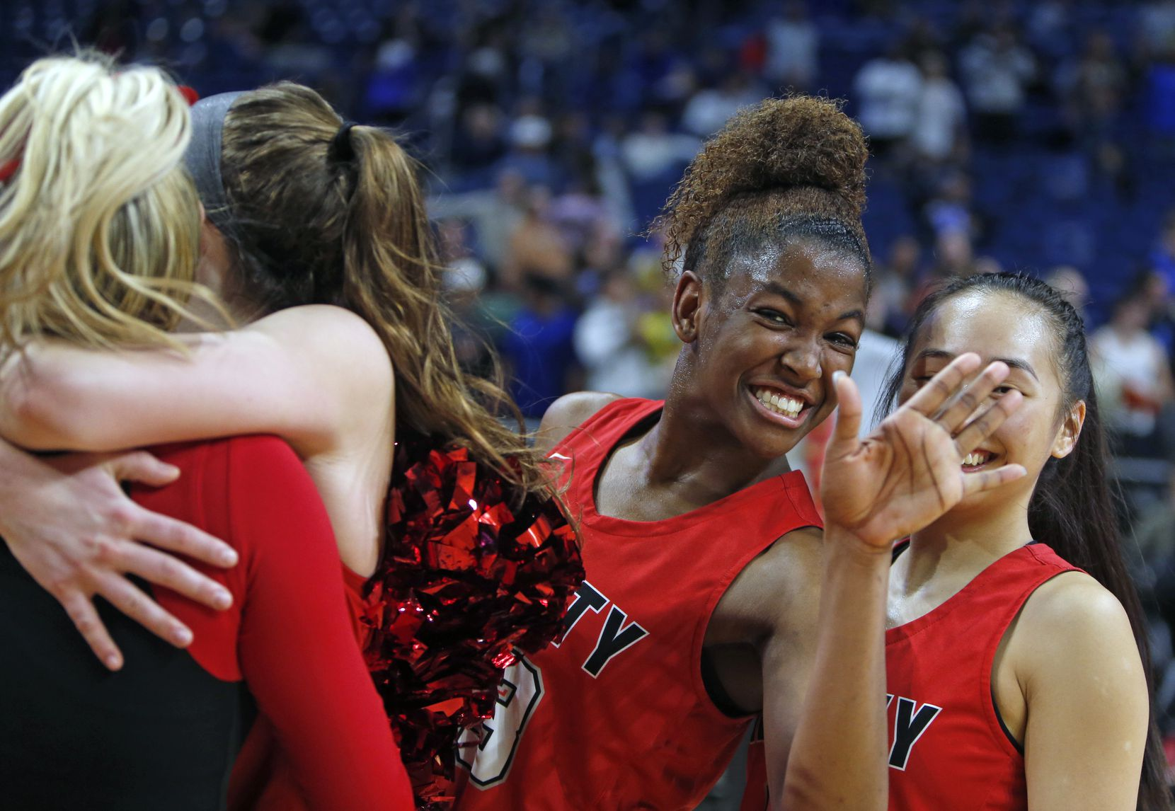Liberty's Randi Thompson mugs for camera as teammates celebrate their victory.  Kerrville Tivy v  Frisco Liberty in 5A semifinals at the Alamodome in San Antonio, TX on Thursday, February 28, 2019.