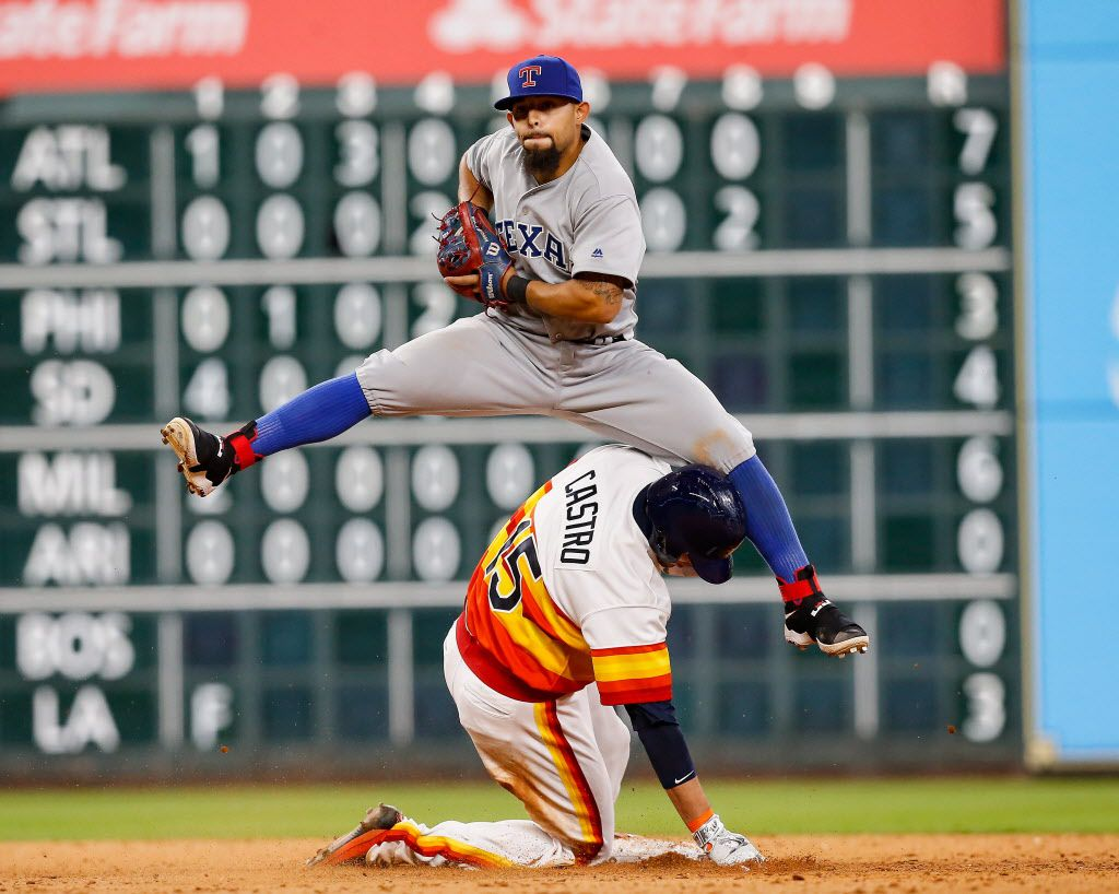 HOUSTON, TX - AUGUST 06:  Rougned Odor #12 of the Texas Rangers leaps over Jason Castro #15 of the Houston Astros as he forces him out in the ninth inning at Minute Maid Park on August 6, 2016 in Houston, Texas.  (Photo by Bob Levey/Getty Images)