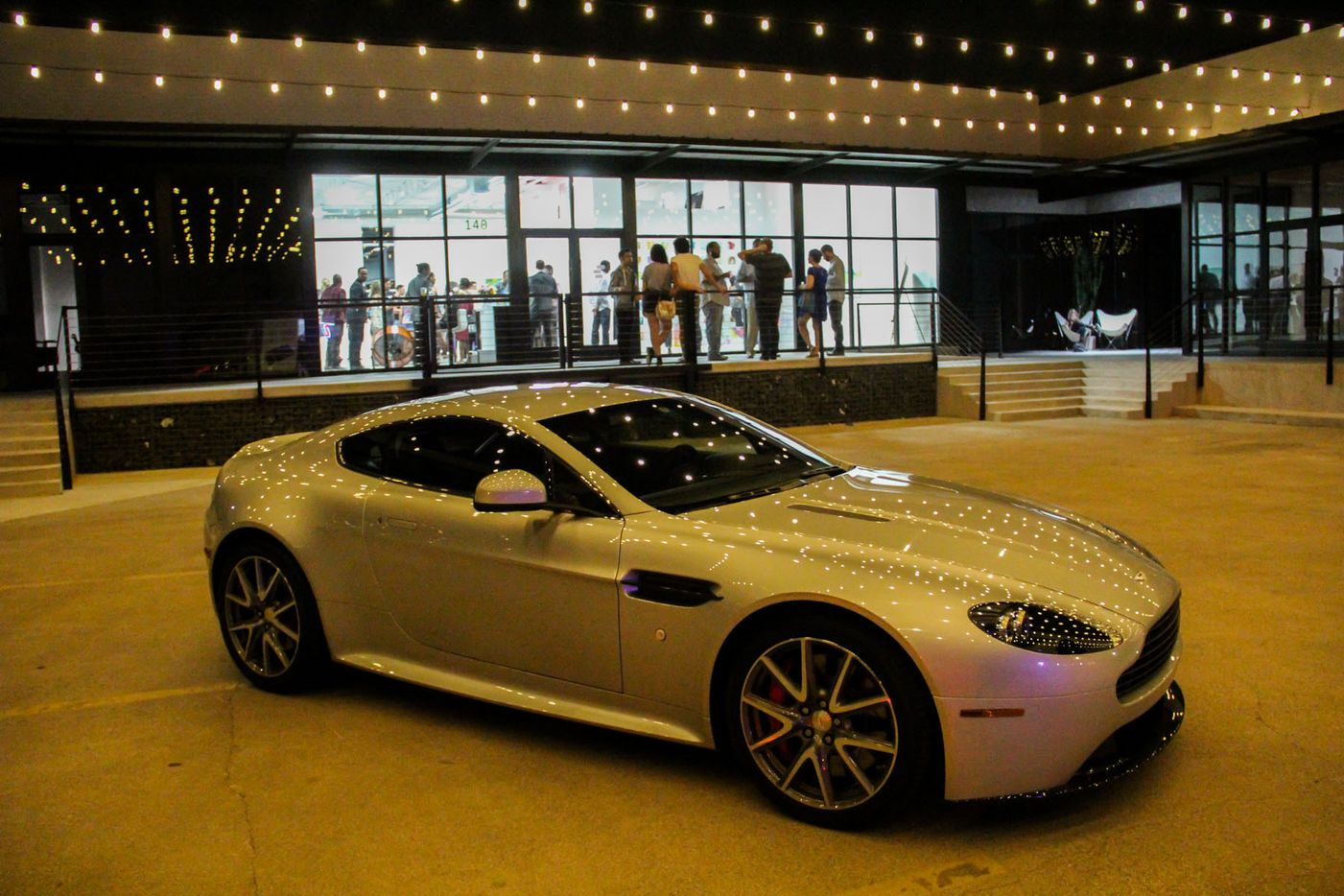 Aston Martin displayed their latest cars at the Random Art Gallery  opening reception of visual artist Tori Martin's Euphoria.