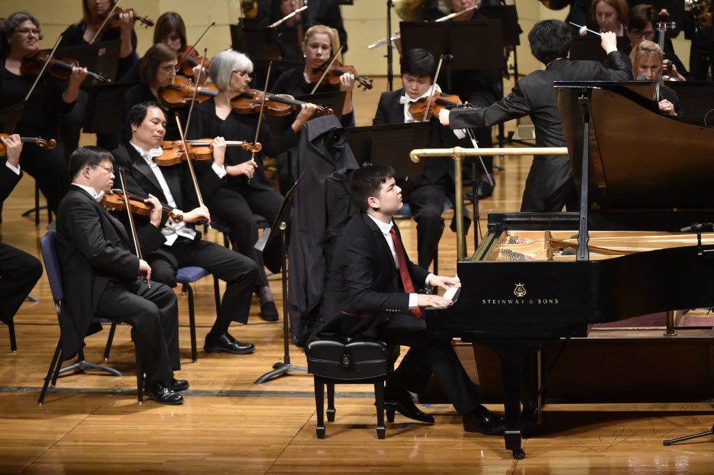 Alim Beisembayev of Kazakhstan plays Tchaikovsky's Piano Concerto No.1 in B-flat Minor, op. 23 with conductor Mei-Ann Chen and the Fort Worth Symphony Orchestra during the first  Cliburn International Junior Piano Competition and Festival at Ed Landreth Auditorium in Fort Worth on June 28, 2015.