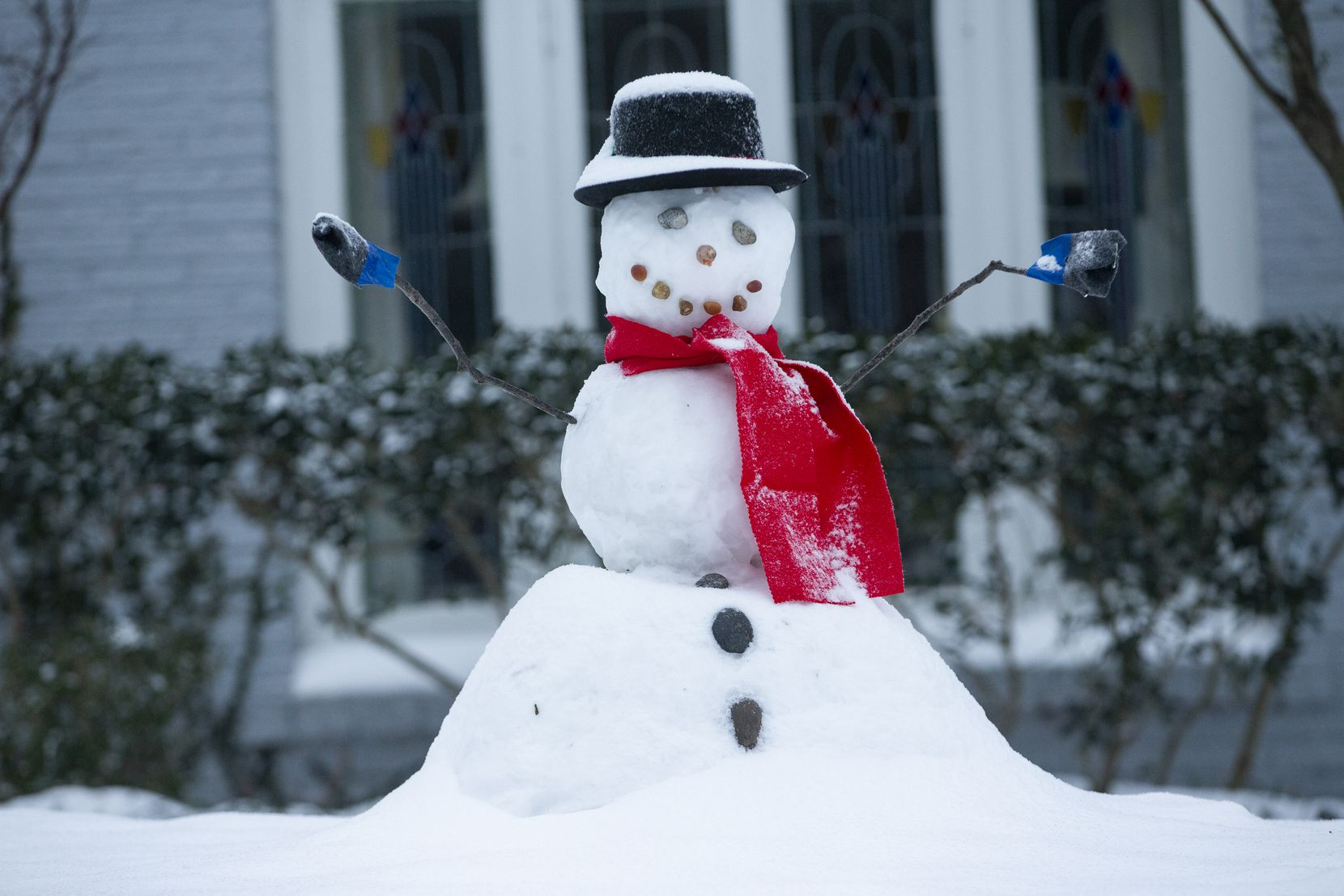 A snowman in Lower Greenville sits with fresh snow on its head in Dallas on Wednesday, Feb. 17, 2021. Millions of Texans have lost power amid this record-breaking winter storm.