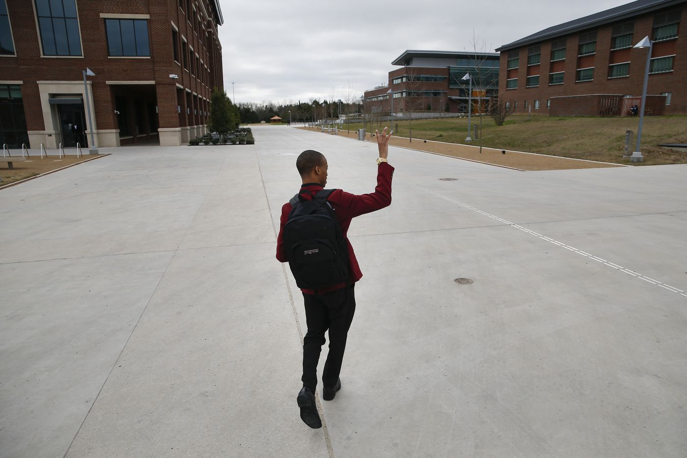 Jaylon Miller waves to a friend across the campus common area at the University of North Texas at Dallas on Wednesday, Jan. 29, 2020 in Dallas.
