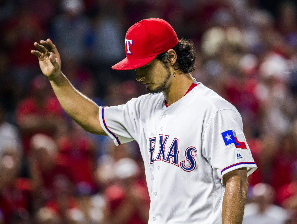 Texas Rangers starting pitcher Yu Darvish (11) waves to fans as he walks to the dugout after being pulled from the game during the seventh inning of their game against the Seattle Mariners on Monday, August 29, 2016 at Globe Life Park in Arlington, Texas.  (Ashley Landis/The Dallas Morning News)