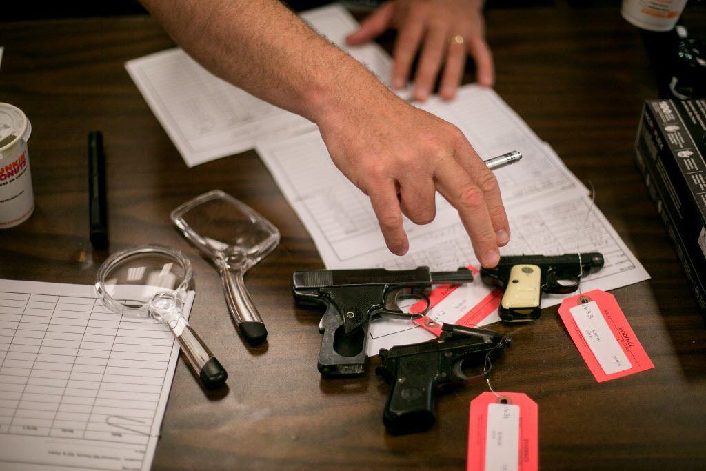 A police officer processes guns turned in during a buyback event at Universal Missionary Baptist Church in Chicago. (Sam Hodgson/The New York Times)