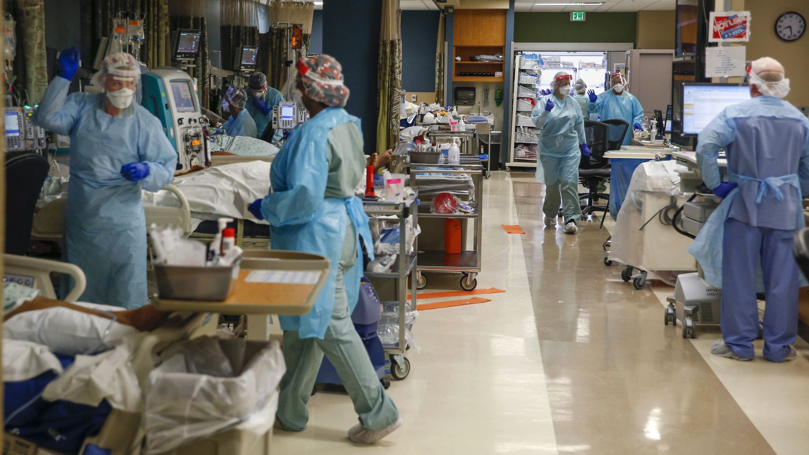 Healthcare workers work to treat critically ill patients who fill bed after bed in the Parkland Hospital COVID-19 Tactical Care Unit on Saturday, June 27, 2020 in Dallas.