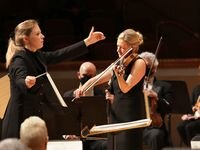 Principal guest conductor Gemma New, left, and violin soloist Angela Fuller Heyde perform with the Dallas Symphony Orchestra at the Meyerson Symphony Center.