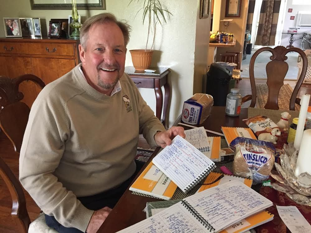 Dallas' Brent Burmaster, the executive director of Soul's Harbor, reviews his running logs. To date, he's run 8,848 consecutive days over the past 24 years.