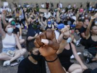 Protesters gather at City Hall for an 8 minute and 46 second moment of silence after marching from Klyde Warren Park during a demonstration against police brutality on Saturday, June 6, 2020 in Dallas. (Ryan Michalesko/The Dallas Morning News)