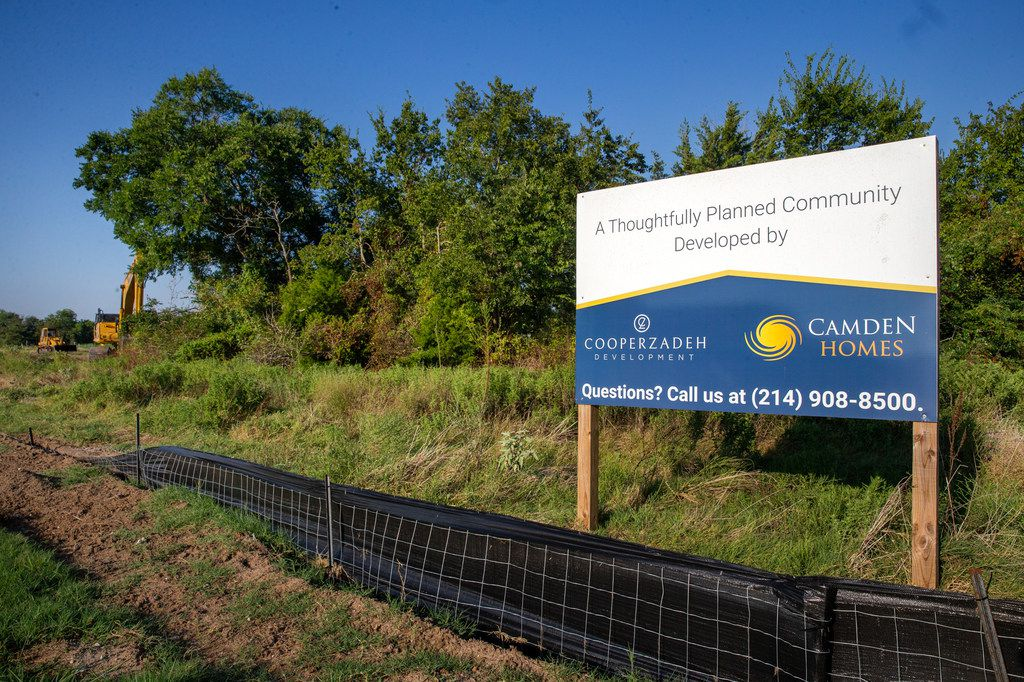 A sign at the site where Camden Homes, with a big assist from the private GrowSouth Fund, is breaking ground on a single-family home development in far southeast Dallas.