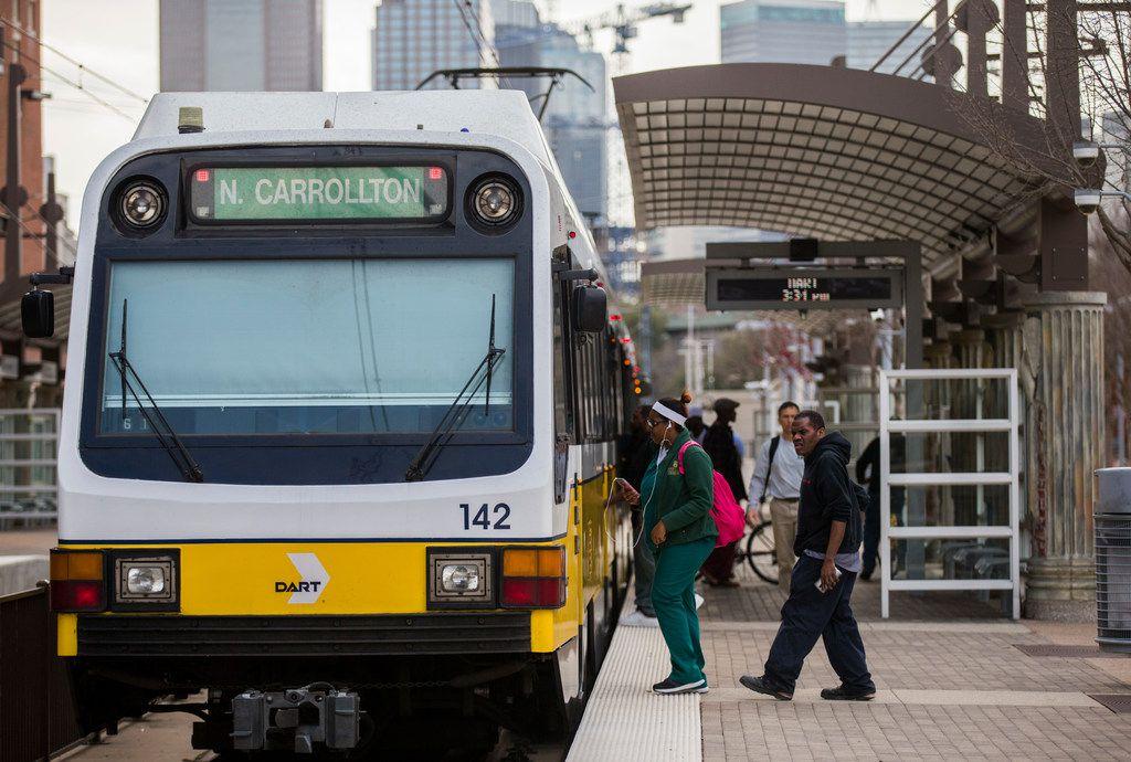 Passengers board a DART train at the Baylor University Medical Center Station.