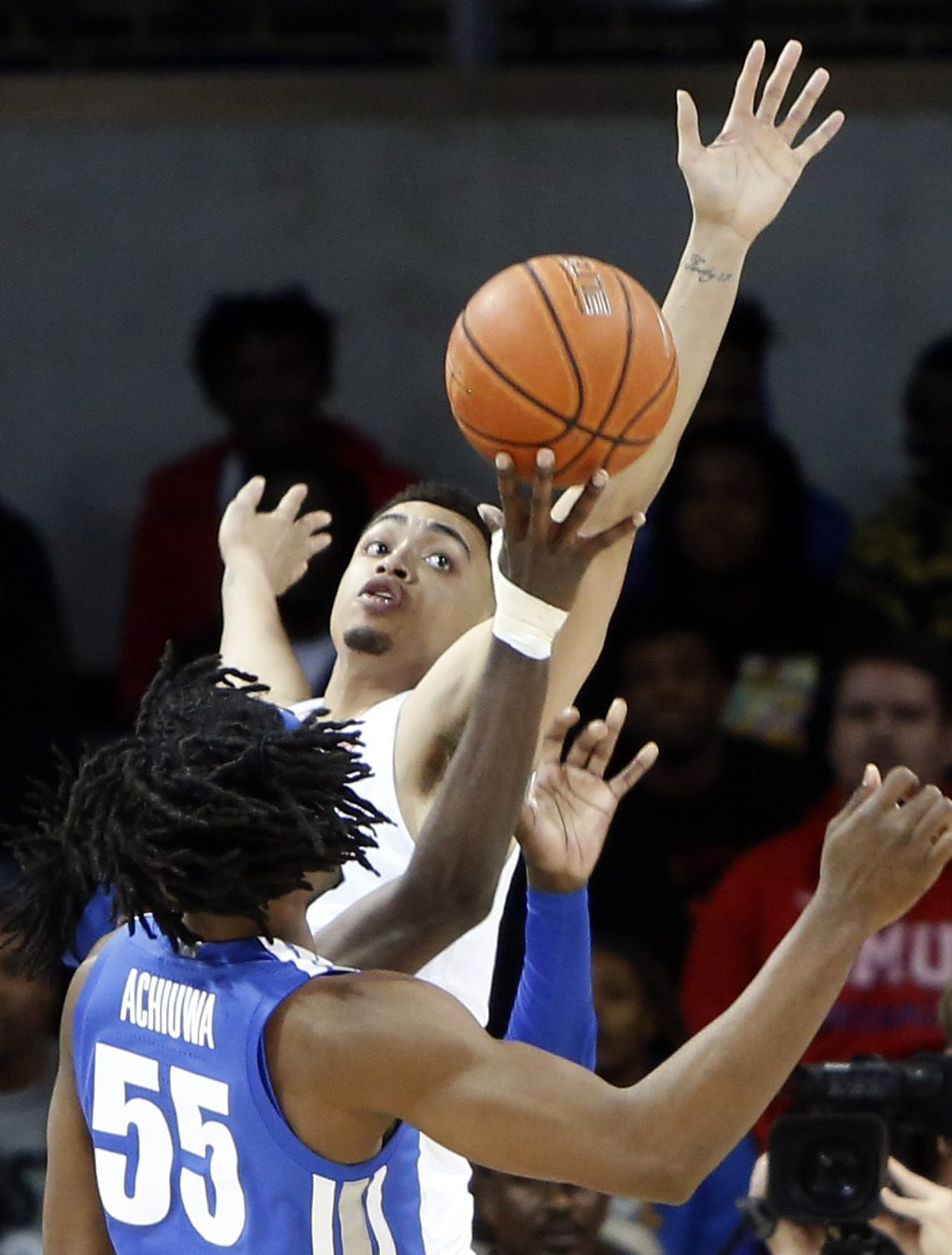 SMU forward Ethan Chargois (25) skies to defend against a shot by Memphis guard Damion Baugh (10) during first half action. The two teams from the NCAA's American Athletic Conference played their men's basketball game at SMU's Moody Coliseum in Dallas on February 25, 2020.