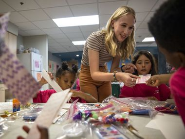 Ella Reaugh, 17, a rising senior at Lovejoy High School, teaches an arts and crafts activity to campers at the Vogel Alcove campus in Dallas. Reaugh raised more than $3,100 for art supplies through a GoFundMe campaign in which she offered prints of her own artwork to encourage donations.
