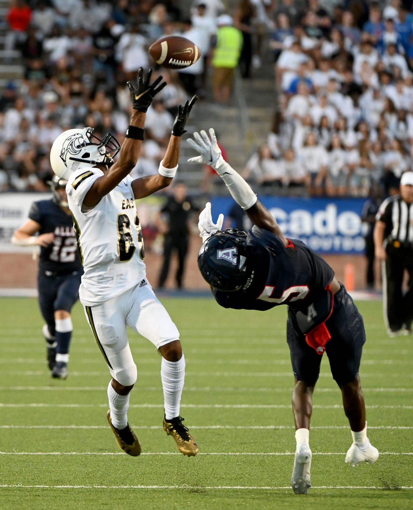 Plano East's Rushil Patel catches a touchdown pass over Allen's Sign Shuva (5) in the first half during a high school football game between Plano East and Allen, Friday, Aug. 27, 2021, in Allen, Texas. (Matt Strasen/Special Contributor)