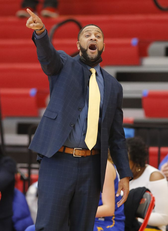 Lakeview Centennial head coach Garron Green shouts instructions to his players during a girls basketball first-round playoff game against Skyline at Hillcrest High School in Dallas, Saturday, February 13, 2021. Skyline won 49-42. (Brandon Wade/Special Contributor)