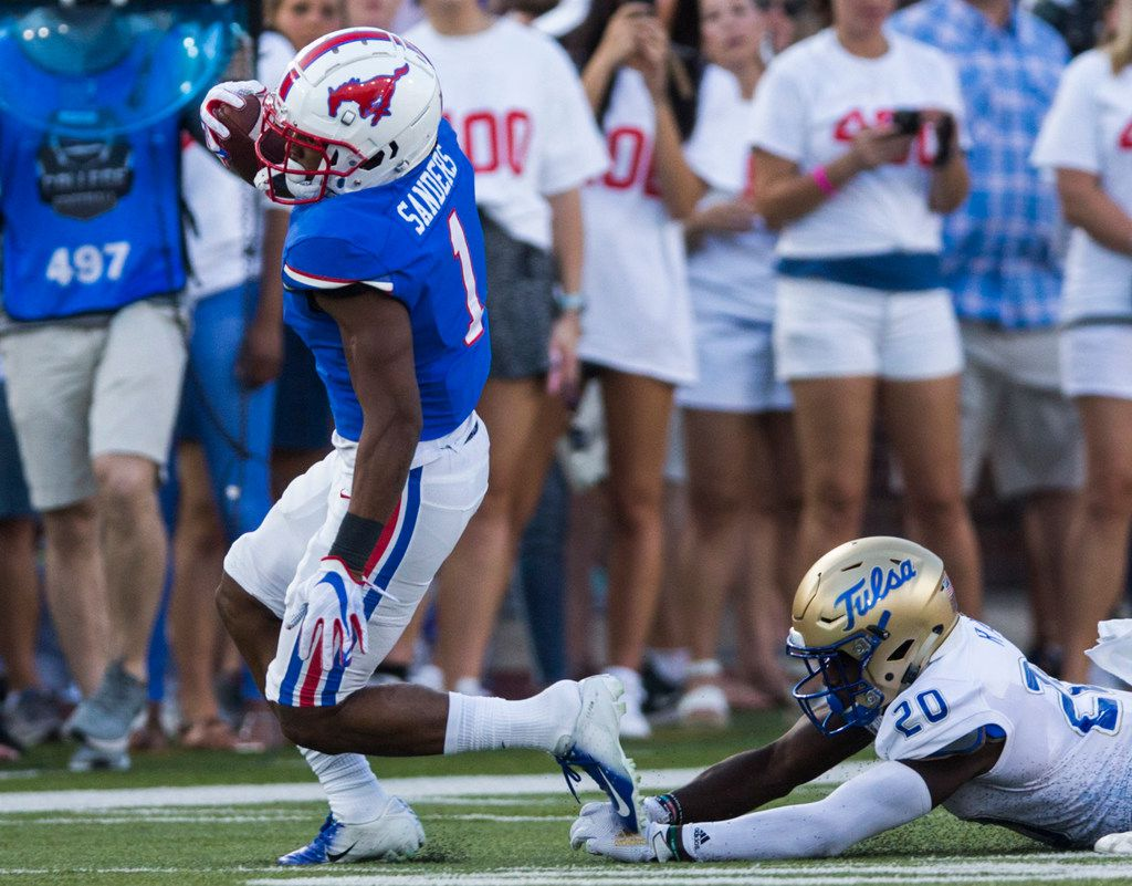 SMU Mustangs wide receiver CJ Sanders (1) runs the ball ahead of Tulsa Golden Hurricane safety Kendarin Ray (20) during the first quarter of an NCAA football game between Tulsa and SMU on Saturday, October 5, 2019 at Ford Stadium on the SMU campus in Dallas. (Ashley Landis/The Dallas Morning News)