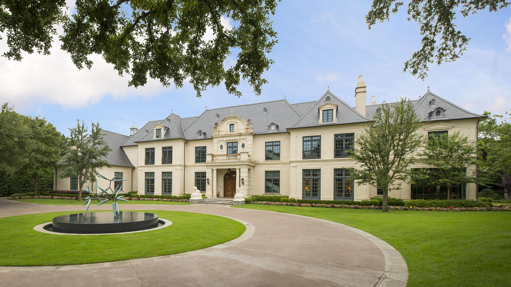 This 3-acre estate in Old Preston Hollow offers six bedrooms, a wine cellar, pool, tennis court, putting green and gardens.