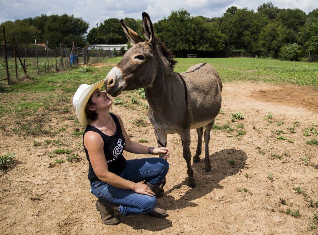 Jess Anselment kisses her donkey, Bunny.