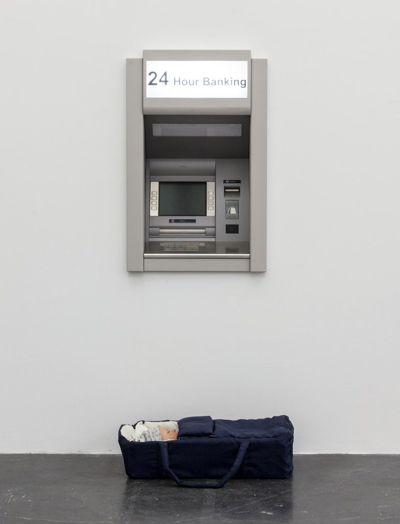 Modern Moses combines an ATM with a baby carrier.
