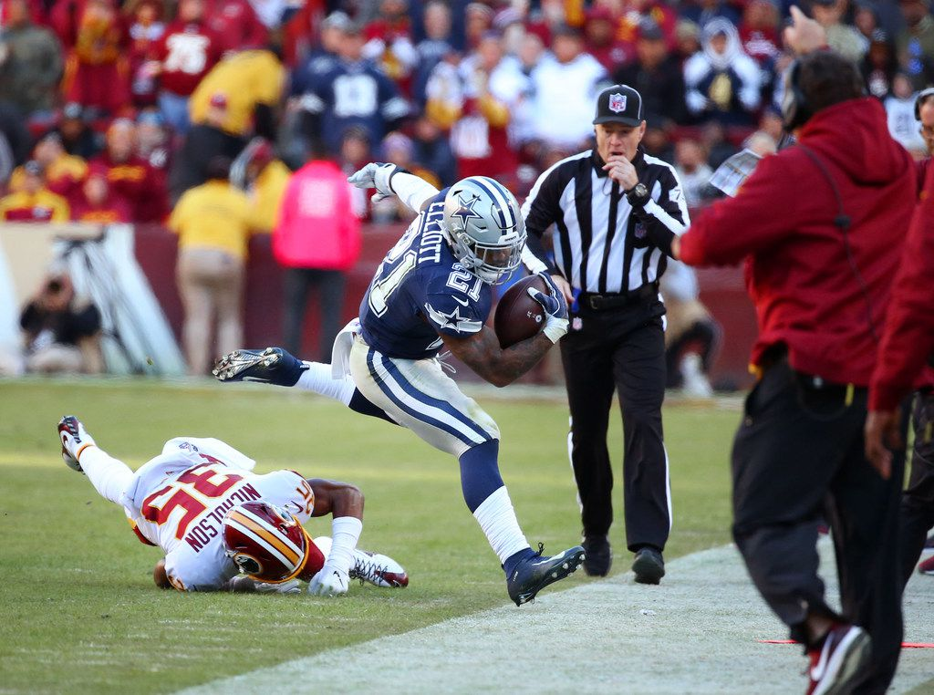 Dallas Cowboys running back Ezekiel Elliott (21) is driven out of bounds by Washington Redskins strong safety Montae Nicholson (35) in the second quarter at FedExField in Landover, Maryland on Sunday, Oct. 21, 2018. (Rose Baca/The Dallas Morning News)