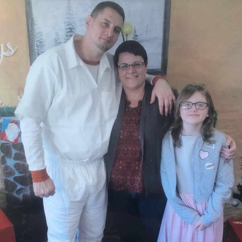 George Powell (left) is pictured with his girlfriend, Tamara Parson, and her daughter, Ciara, in December. Powell was convicted of armed robbery in 2009 but was granted a retrial this week after a judge found his due process rights had been violated.