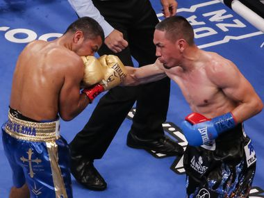 Juan Francisco Estrada, right, lands a punch on Roman Gonzalez during the WBC, WBA and Ring Magazine World Super-Flyweight titles boxing bout in Dallas, Saturday, March 13, 2021. Estrada was declared the winner in a split decision.