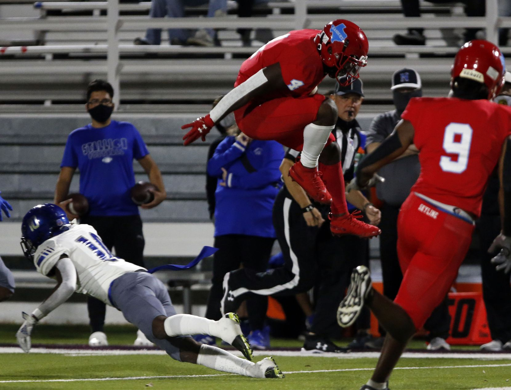 Skyline's Qualon Farrar (4) leaps high to avoid a tackler during the first half of a high school football game against  Skyline North Mesquite High at Forester Field in Dallas on Thursday, November 19, 2020.