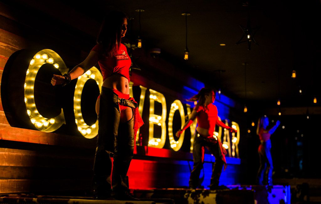 Boot, scoot and booty: Dancers in chaps perform at PBR Texas, a honky tonk club, at Texas Live in Arlington.