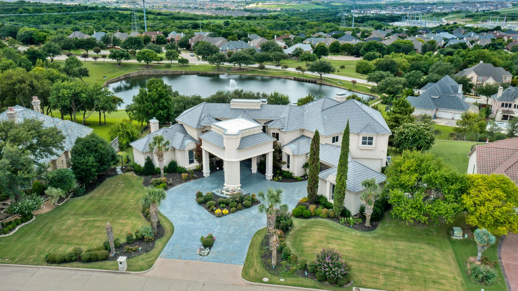 The estate at 6441 Sudbury Road in Plano's guard-gated Kings Gate is offered at $2,850,000.