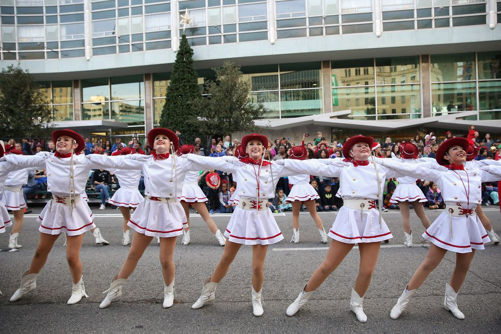The Cardettes of Trinity Valley Community College perform during the Dallas Holiday Parade through downtown Dallas.