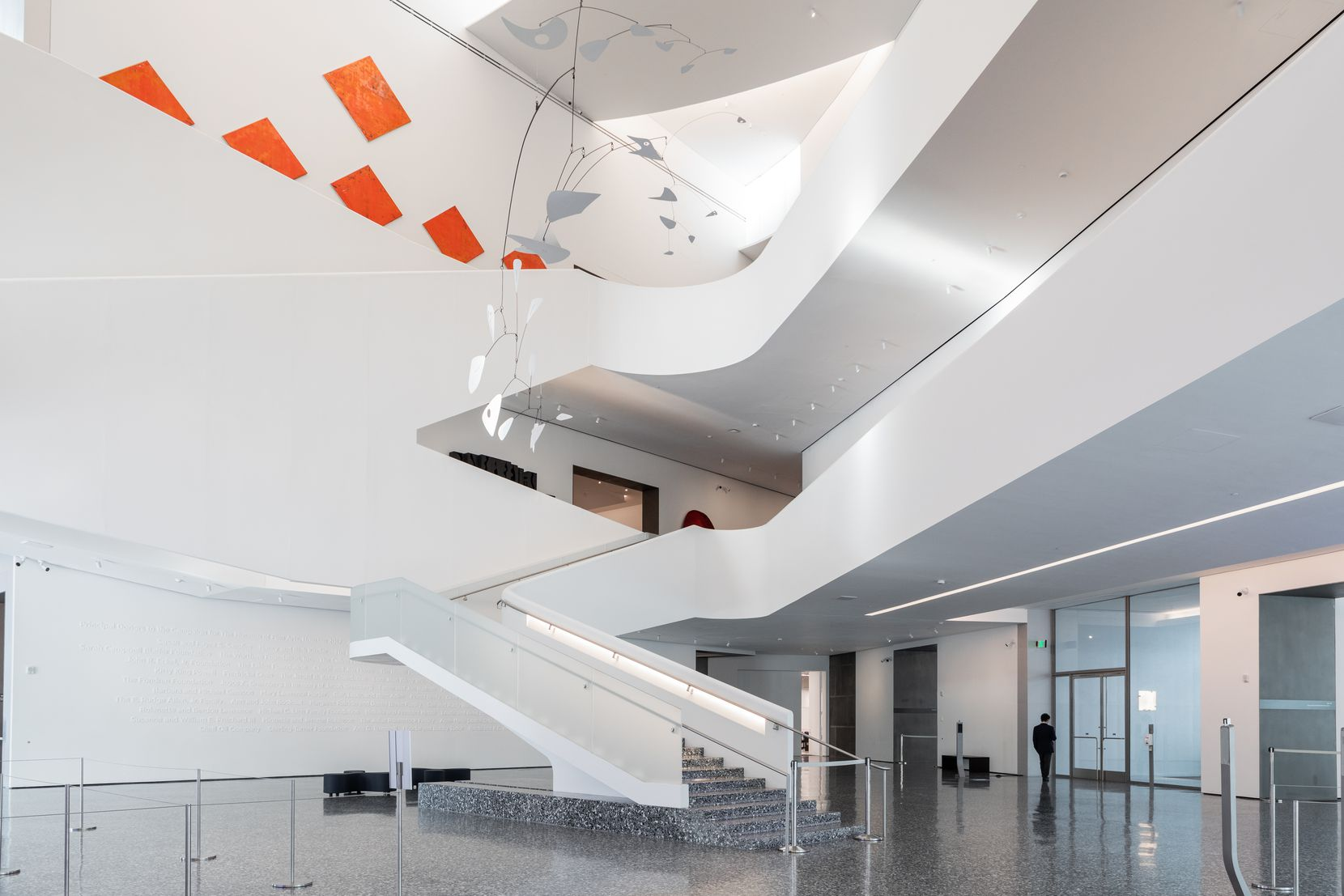 Galleries ring the space above the Kinder Building's atrium.