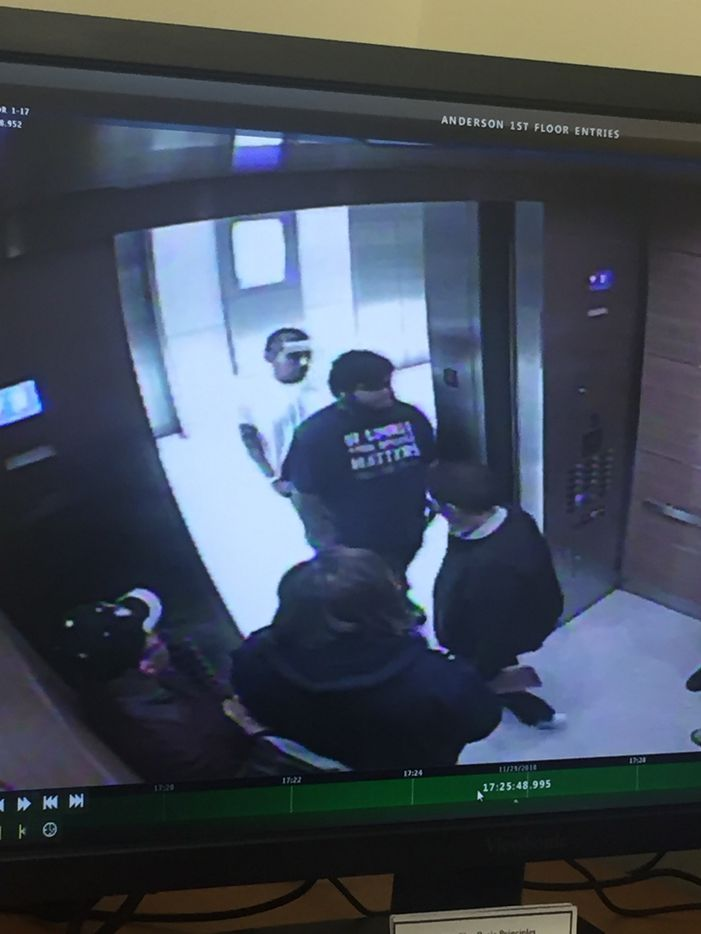 Surveillance footage shows Alfredo Castro in an elevator and standing outside a building.
