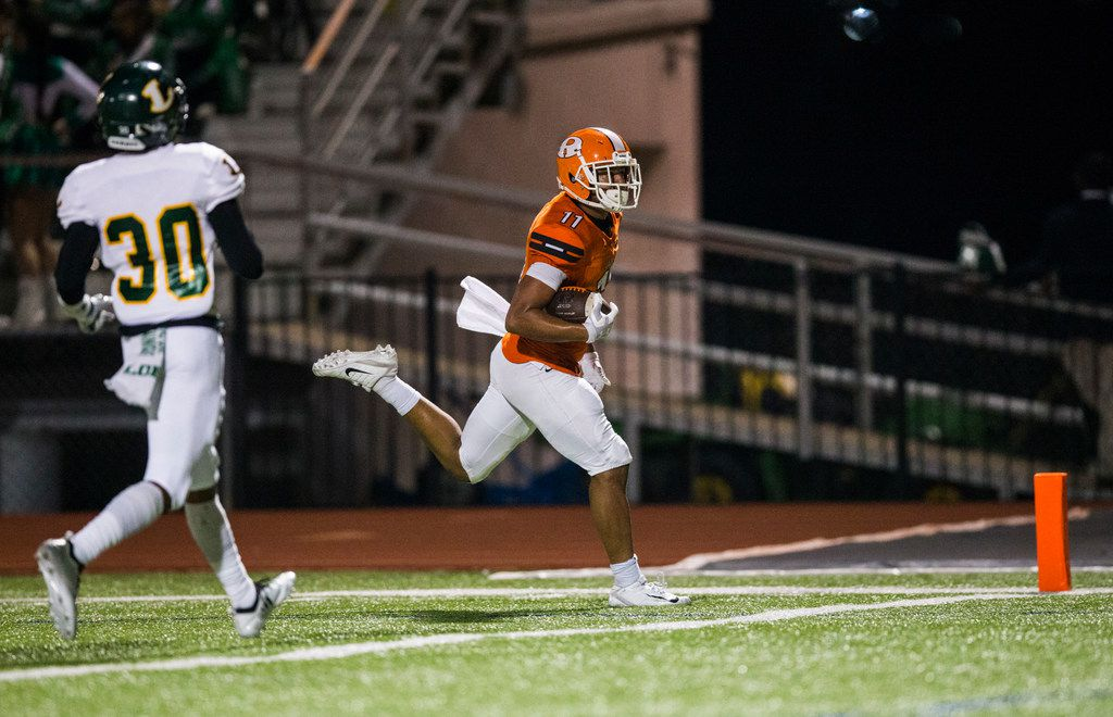 Rockwall wide receiver Jaxon Smith (11) runs to the end zone for a touchdown ahead of Longview defensive back Tainique Taylor (30) during the first quarter of a District 11 6A high school football game between Longview and Rockwall on Friday, September 28, 2018 at Wilkerson-Sanders Stadium in Rockwall, Texas. (Ashley Landis/The Dallas Morning News)