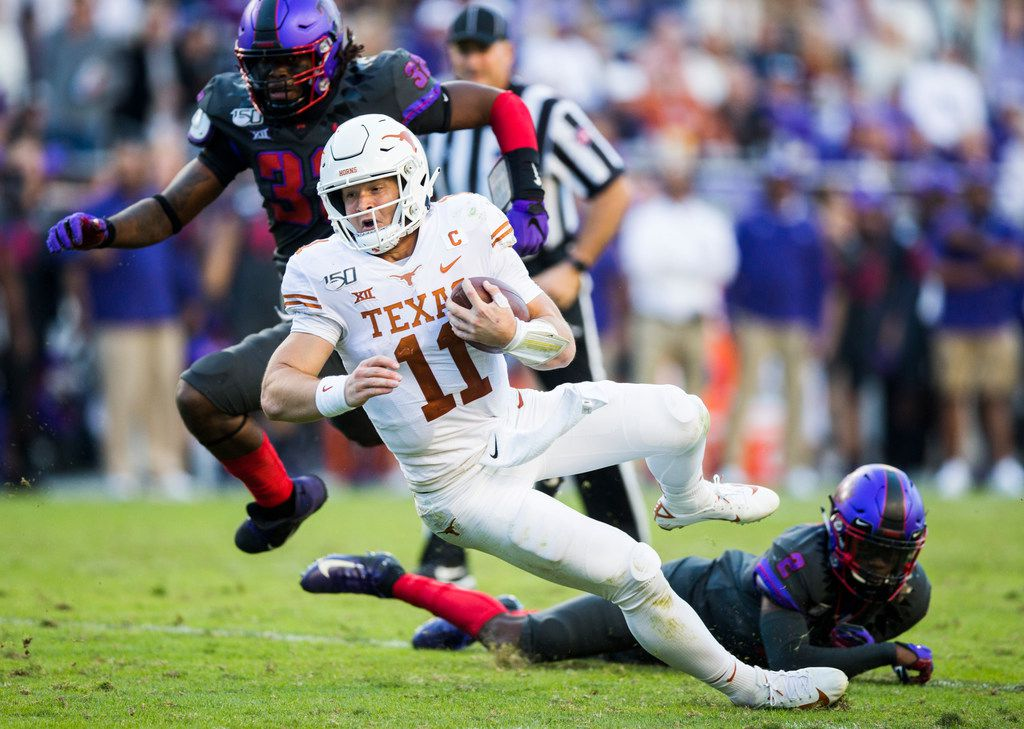 Texas quarterback Sam Ehlinger goes down during the Longhorns' 37-27 loss to TCU on Saturday, October 26, 2019 at Amon G Carter Stadium in Fort Worth. (Ashley Landis/The Dallas Morning News)