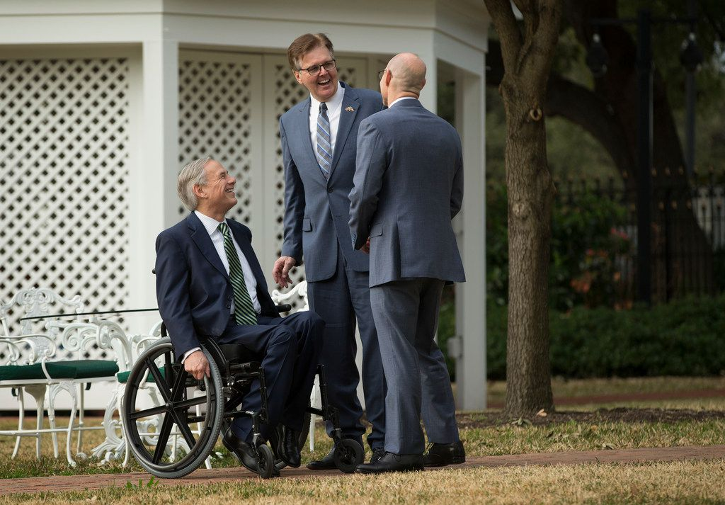 Gov. Greg Abbott, from left, Lt. Gov. Dan Patrick and House Speaker Dennis Bonnen share a laugh before speaking at a news conference at the Governor's Mansion in Austin, Texas, on Wednesday, January 9, 2019. (Jay Janner/Austin American-Statesman via AP)