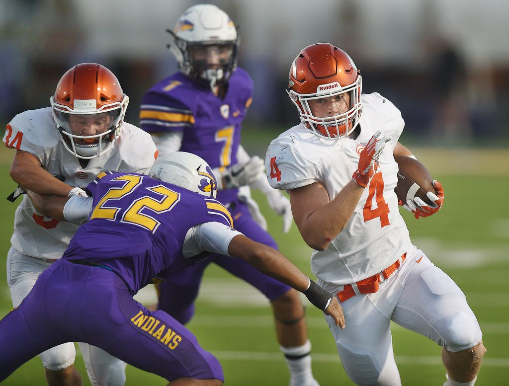 Sanger defensive back Elijah Ritzel (22) fights off a block trying to tackle Celina running back Logan Point (4) in the first half of their game at Indian Stadium Friday, September 28, 2018, in Sanger, Tx. Photo by Al Key/For the DRC
