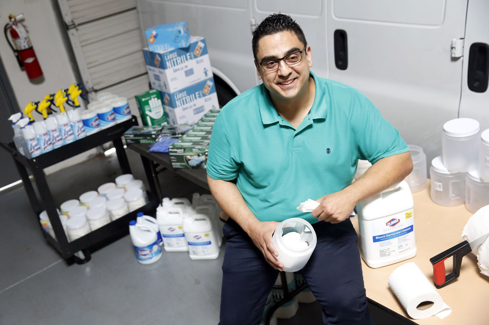 BCI Janitorial head of business development Oscar DeLeon is shown with some of the company's cleaning supplies and disinfectants. BCI Janitorial is a third-generation, family-owned small business that provides janitorial services to commercial clients from its Carrollton office.