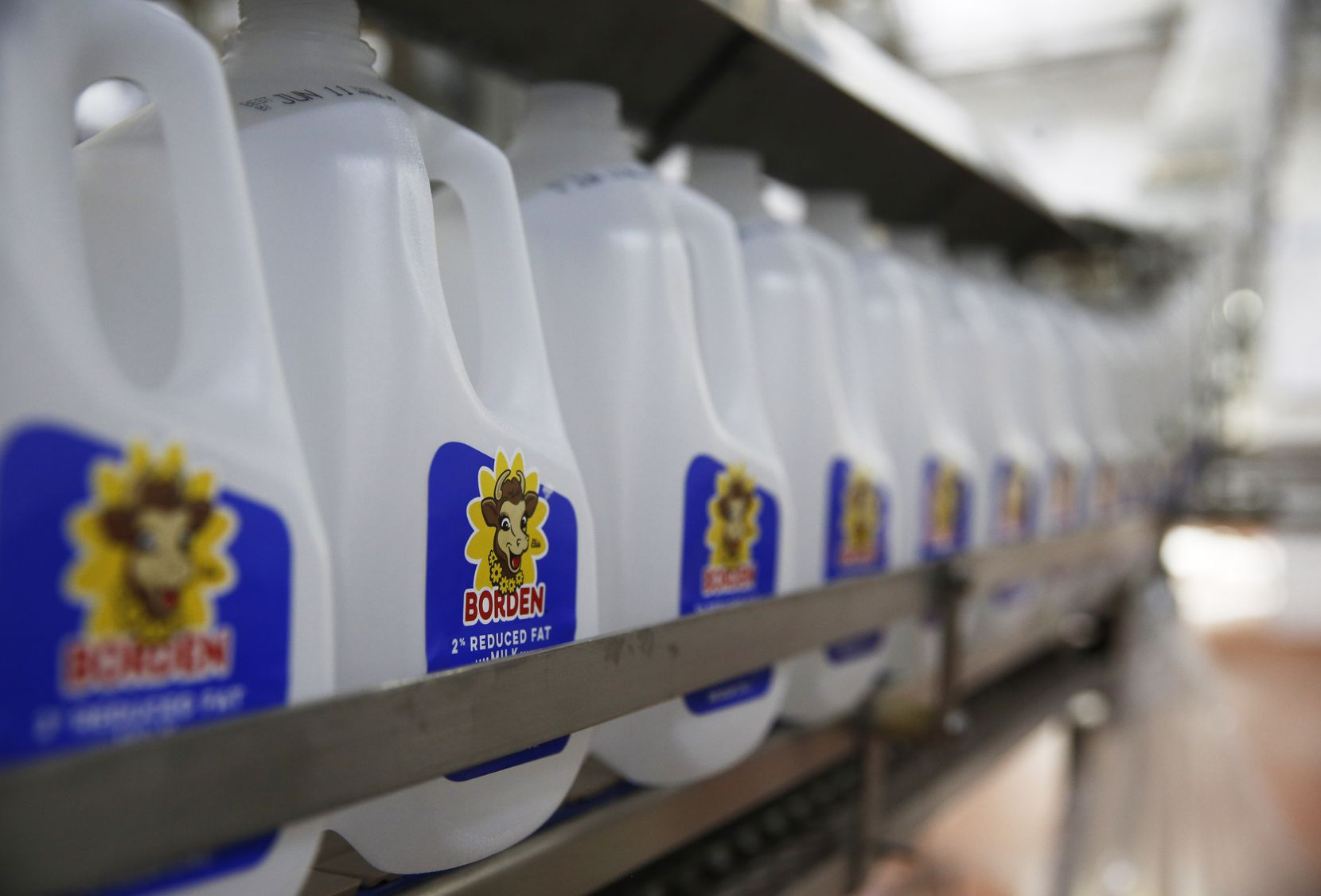 Empty bottles of Borden 2% reduced fat milk bottles make their way through the bottling line at Borden Dairy Co. in Dallas.